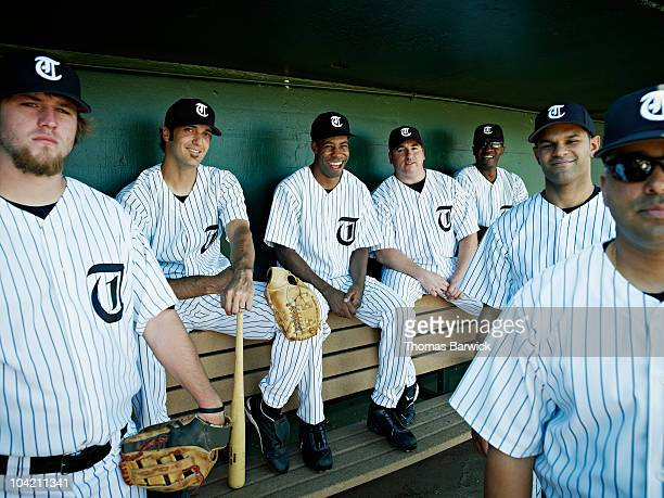 Professional baseball team sitting in dugout