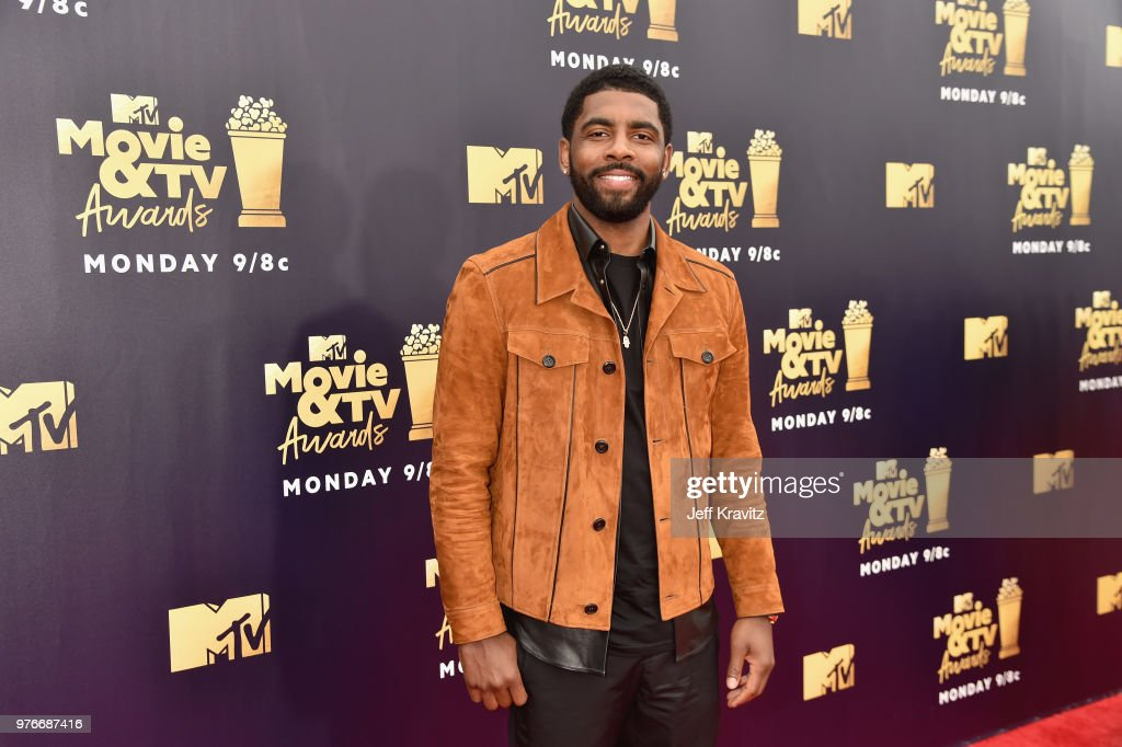 Professional baskbetball player Kyrie Irving attends the 2018 MTV Movie And TV Awards at Barker Hangar on June 16, 2018 in Santa Monica, California.