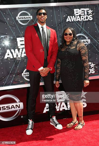 Professional basketball player Anthony Davis and Erainer Davis attend the 2015 BET Awards at the Microsoft Theater on June 28 2015 in Los Angeles...