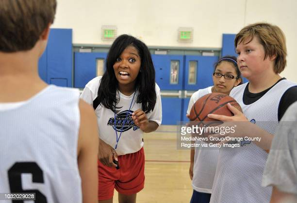 BEACH CALIF USA Professional basketball player Brittanie TaylorJames works with youngsters on the first day of the Pete Davis Legends Basketbal Camp...