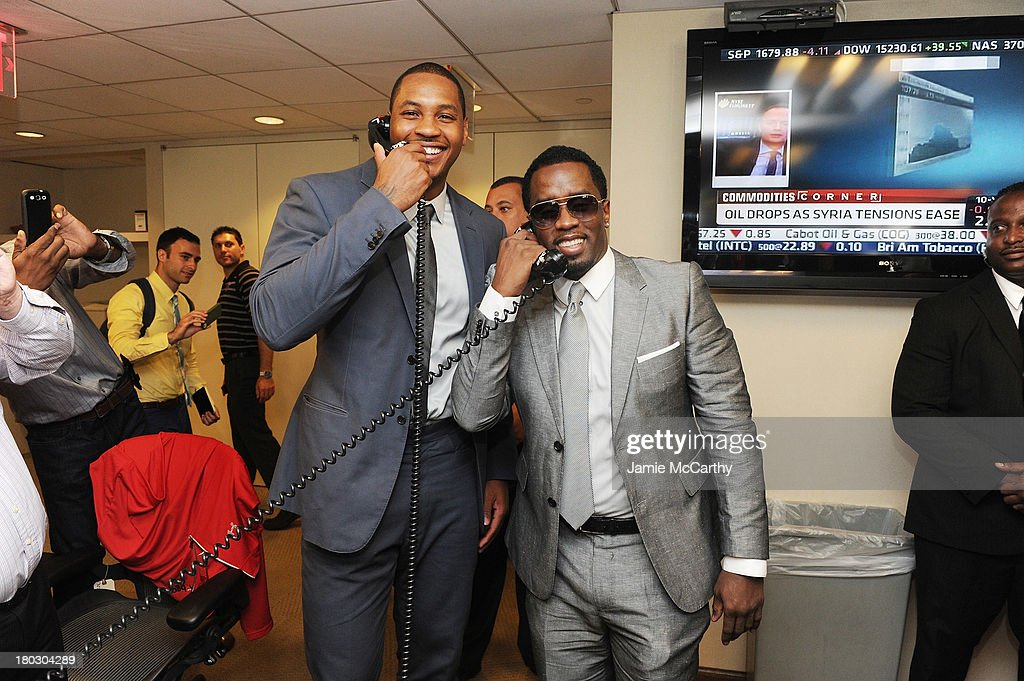 Professional basketball player Carmelo Anthony (L) and rapper P. Diddy attend the annual charity day hosted by Cantor Fitzgerald and BGC at the BGC office on September 11, 2013 in New York City.