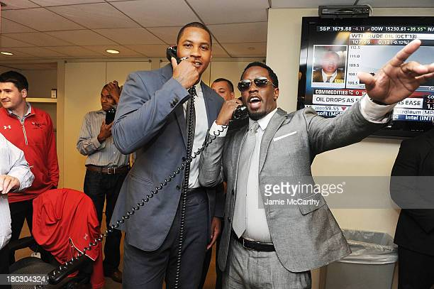 Professional basketball player Carmelo Anthony and rapper P Diddy attend the annual charity day hosted by Cantor Fitzgerald and BGC at the BGC office...