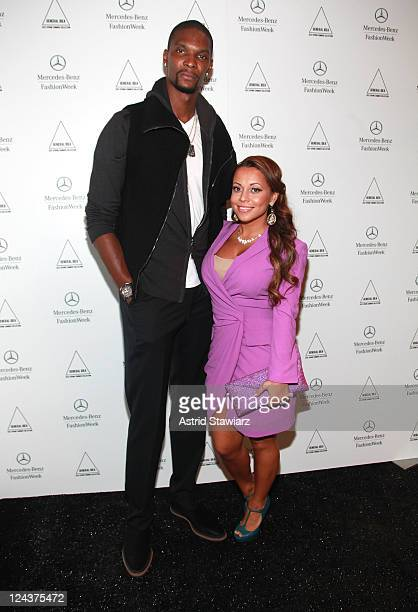 Professional basketball player Chris Bosh and Adrienne Bosh pose backstage at the General Idea Spring 2012 fashion show during MercedesBenz Fashion...