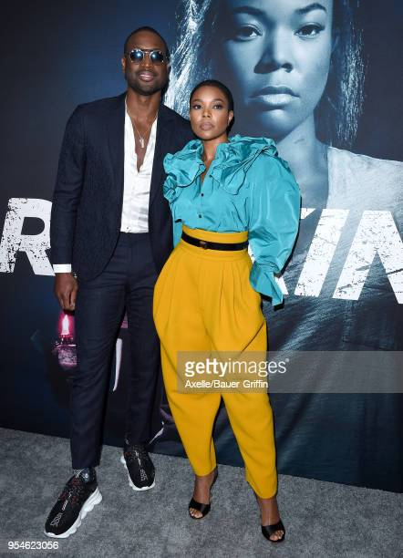 Professional basketball player Dwyane Wade and actress Gabrielle Union arrive at Universal Pictures' special screening of 'Breaking In' at ArcLight...