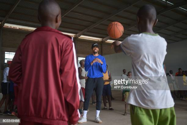 TOPSHOT US professional basketball player for the Golden State Warriors of the National Basketball Association James Michael McAdoo receives a pass...