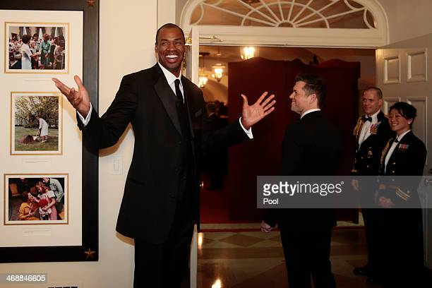 Professional basketball player Jason Collins, left, arrives to a state dinner hosted by U.S. President Barack Obama and U.S. First lady Michelle...