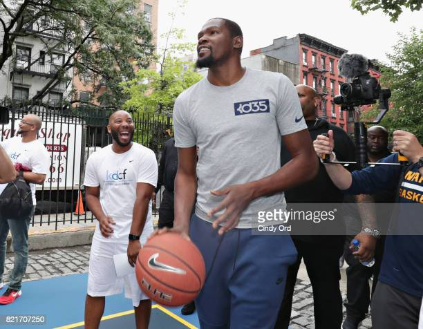 Professional basketball player Kevin Durant enters the basketball court during the KD Build It and They Will Ball court ceremony on July 24 2017 in...