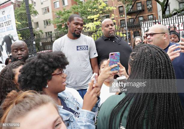Professional basketball player Kevin Durant poses for photos with attendees during the KD Build It and They Will Ball court ceremony on July 24 2017...