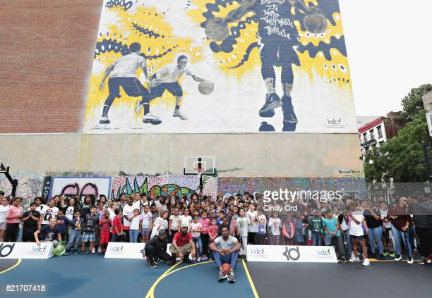 Professional basketball player Kevin Durant poses with students during the KD Build It and They Will Ball court ceremony on July 24 2017 in New York...