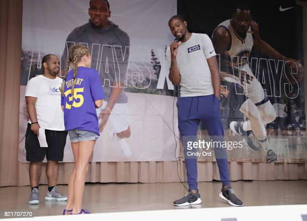 Professional basketball player Kevin Durant takes a question from a student during the KD Build It and They Will Ball court ceremony on July 24 2017...