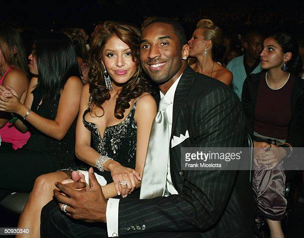 Professional basketball player Kobe Bryant and his wife Vanessa pose at the 2004 MTV Movie Awards at the Sony Pictures Studios on June 5 2004 in...