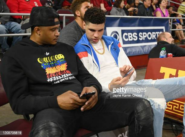 Professional basketball player LaMelo Ball right attends the game between the USC Trojans and the UCLA Bruins at Galen Center on March 7 2020 in Los...