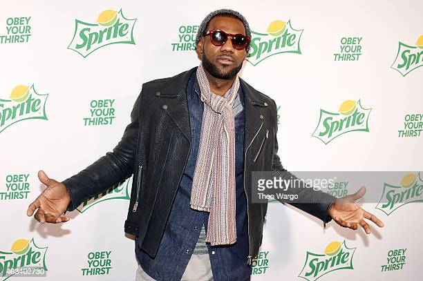 Professional basketball player LeBron James poses on the green carpet before the Sprite Obey Your Thirst Concert featuring hiphop artists Drake Nas...