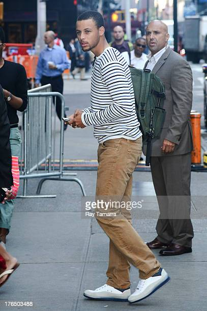 Professional basketball player Stephen Curry enters the 'Good Morning America' taping at the ABC Times Square Studios on August 14 2013 in New York...