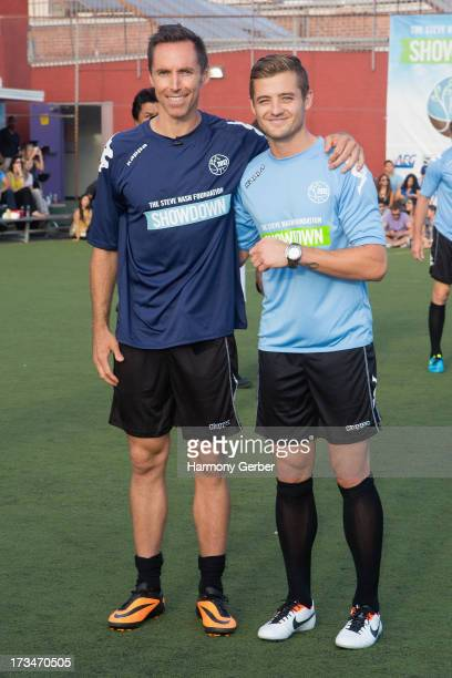 Professional basketball player Steve Nash and professional soccer player Robbie Rogers play soccer at the Salvation Army Red Shield Youth Community...