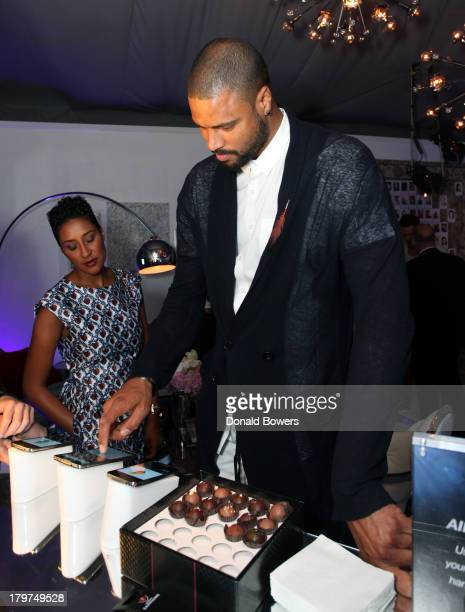 Professional basketball player Tyson Chandler and Kimberly Chandler attend the Samsung Galaxy Blue Room at MercedesBenz Fashion Week Spring 2014...