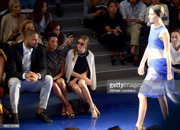 Professional basketball player Tyson Chandler Kimberly Chandler and Olivia Palermo attend the Vera Wang fashion show during MercedesBenz Fashion Week...