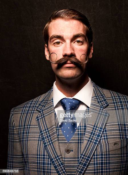 professional beard competitor - checked suit stock pictures, royalty-free photos & images