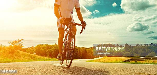 Professional bicyclist rides his bike on a country road