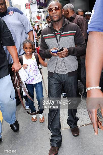 Professional boxer Floyd Mayweather Jr and his daugher Iyanna Mayweather leave his Midtown Manhattan hotel on June 28 2011 in New York City