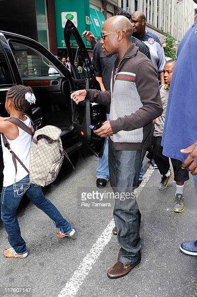 Professional boxer Floyd Mayweather Jr and his daugher Iyanna Mayweather leaves his Midtown Manhattan hotel on June 28 2011 in New York City