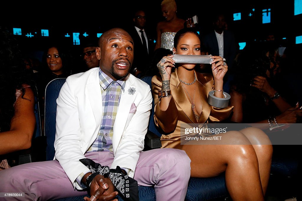 Professional boxer Floyd Mayweather, Jr. (L) and recording artist Rihanna attend the 2015 BET Awards at the Microsoft Theater on June 28, 2015 in Los Angeles, California.