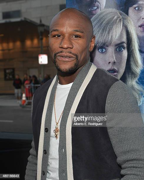 Professional Boxer Floyd Mayweather Jr arrives to the premiere of Open Road Films' 'A Haunted House 2' at Regal Cinemas LA Live on April 16 2014 in...