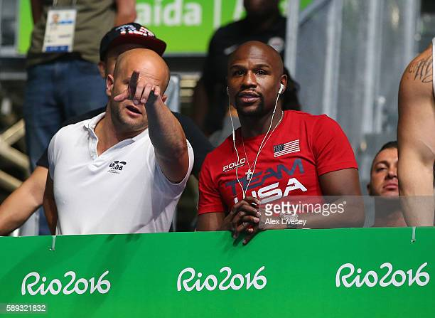 Professional boxer Floyd Mayweather of USA watches the Olympic Boxing on Day 8 of the 2016 Rio Olympics at Riocentro Pavilion 6 on August 13 2016 in...
