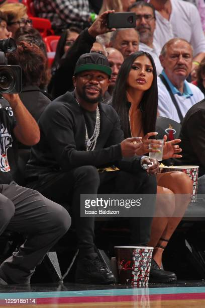 Professional boxer Floyd Mayweather smiles during a game between the Washington Wizards and Miami Heat on December 6, 2019 at American Airlines Arena...