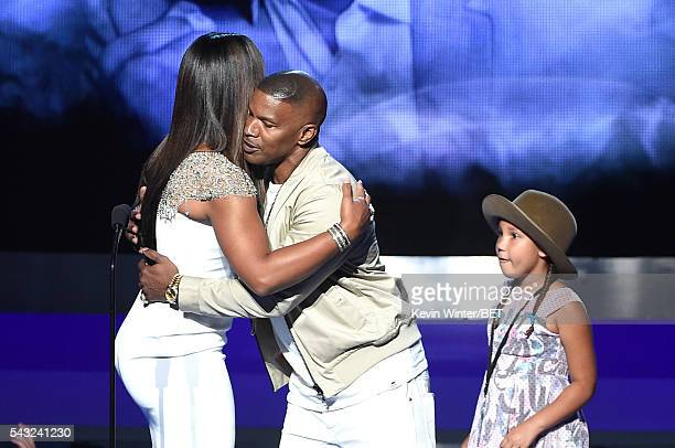 Professional boxer Laila Ali actor Jamie Foxx and daughter Annalise Bishop speak onstage during the 2016 BET Awards at the Microsoft Theater on June...