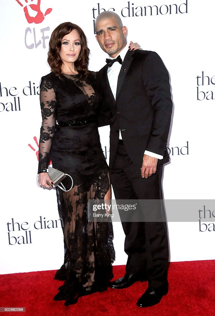 Professional Boxer Miguel Cotto (R) and Melissa Cotto attend the Rihanna And The Clara Lionel Foundation 2nd Annual Diamond Ball at The Barker Hanger on December 10, 2015 in Santa Monica, California.