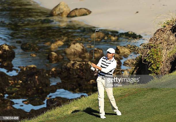 Professional boxer Oscar de la Hoya hits his second shot on the 6th hole during the third round of the ATT Pebble Beach National ProAm at the Pebble...