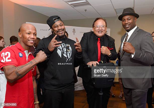 Professional boxer Zab Judah professional football player Marsahwn Lynch Monster Cable CEO Noel Lee and professional boxer Lennox Lewis attend the...