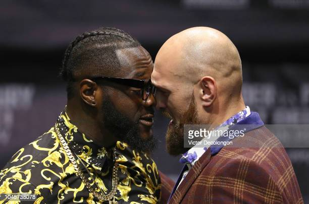 Professional boxers Deontay Wilder and Tyson Fury butt heads onstage during a press conference to promote their upcoming December 1 2018 fight in Los...