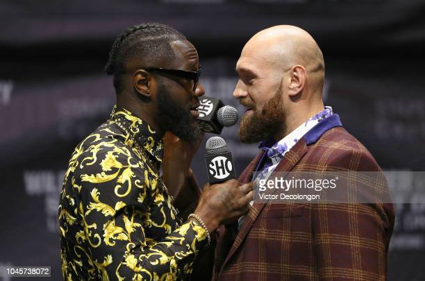 Professional boxers Deontay Wilder and Tyson Fury speak facetoface onstage during a press conference to promote their upcoming December 1 2018 fight...