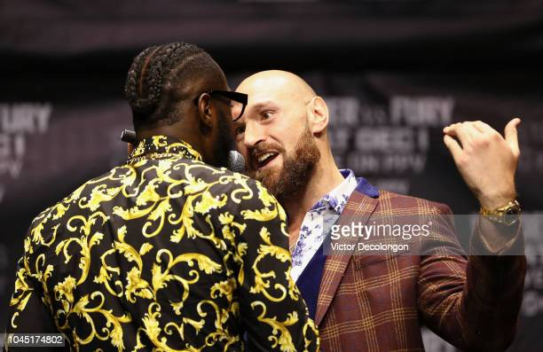 Professional boxers Deontay Wilder and Tyson Fury speak onstage during their press conference to promote their upcoming December 1 2018 fight in Los...