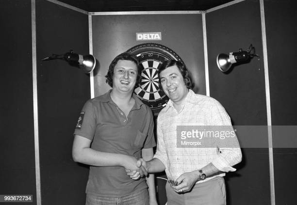 Professional British dart player Eric Bristow poses with winner John Lowe after finishing as runner up in their recent tournament March 1978