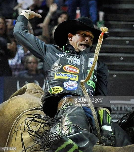 Professional bull rider JB Mauney rides Percolator at the Professional Bull Riders Built Ford Tough World Finals at the Thomas Mack Center on October...