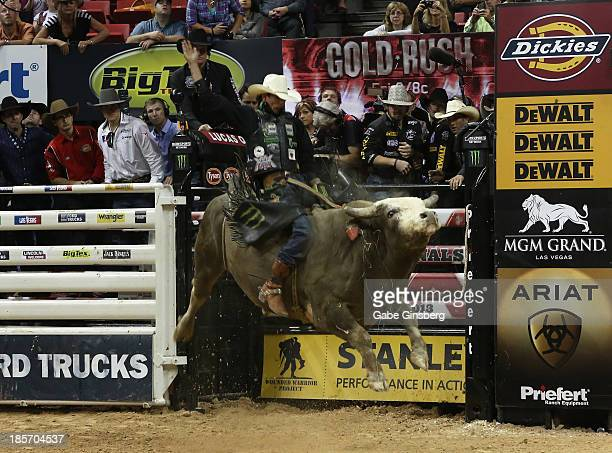 Professional bull rider JB Mauney rides the bull Train Robber at the Professional Bull Riders Built Ford Tough World Finals at the Thomas Mack Center...