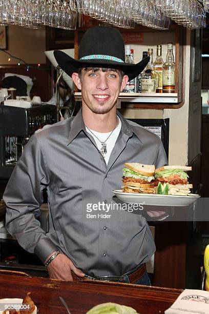 Professional Bull Rider JB Mauney unveils the PBR Bull Bucking Hero at the Stage Deli on January 5 2010 in New York City