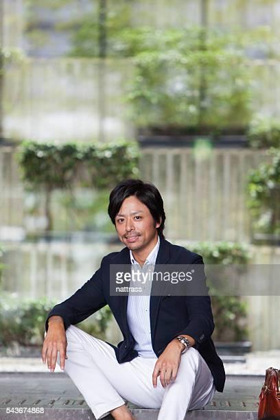 Professional businessman looking at camera