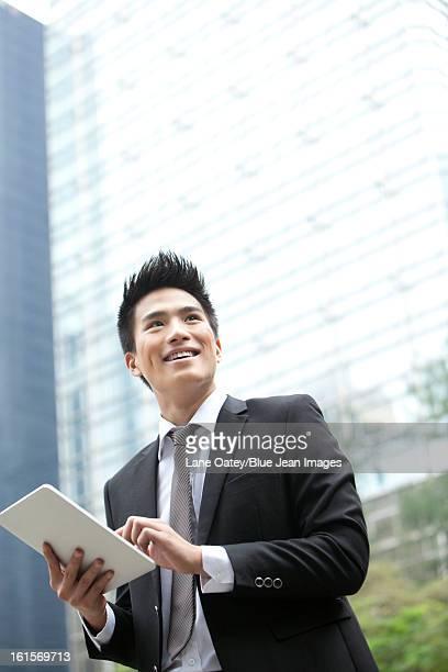 Professional businessman with digital tablet, Hong Kong