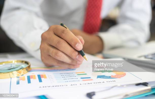 professional businessman working with calculator, doing finance on laptop, document graph and analysis business strategy to development profit. - show business stock-fotos und bilder