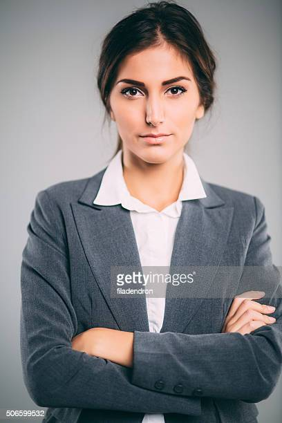professional businesswoman - gray suit stock pictures, royalty-free photos & images
