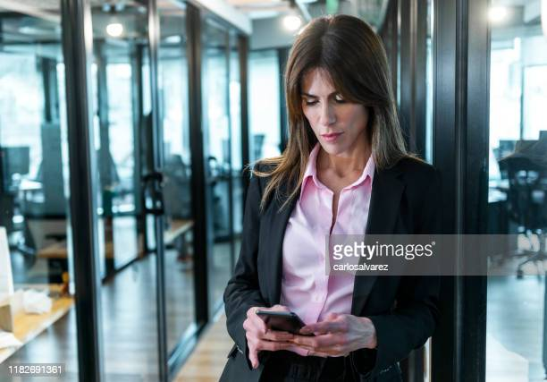 professional businesswoman using smartphone - istock images stock pictures, royalty-free photos & images