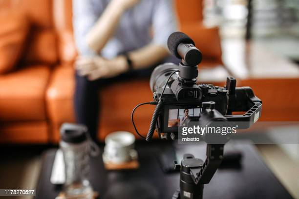 professional camera filming a video podcast - filming stock pictures, royalty-free photos & images