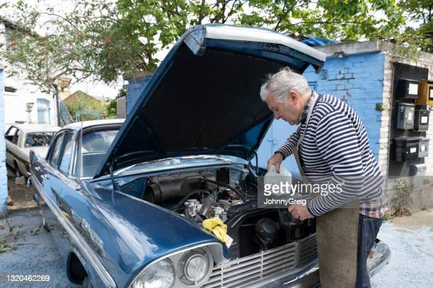 professional car restorer maintaining engine health - 20th century stock pictures, royalty-free photos & images
