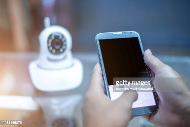 professional cctv technician working. - business security camera stock pictures, royalty-free photos & images