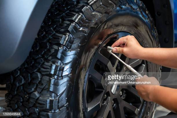 professional checking tire pressure. - inflating stock pictures, royalty-free photos & images