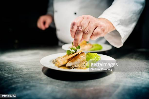 professional chef at work - food and drink stock pictures, royalty-free photos & images